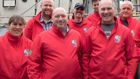 Mark Collins (centre) with his Round Britain team, the former Navy serviceman has spoken of how he h
