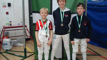 Sidmouth and East Devon Fencing Club members Alex Moore, Toby Moore and Donnie Cass. Picture CONTRIB