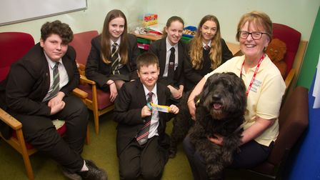 Polly the therapy dog at Sidmouth College with some students. Ref shs 03 19TI 8563. Picture: Terry I