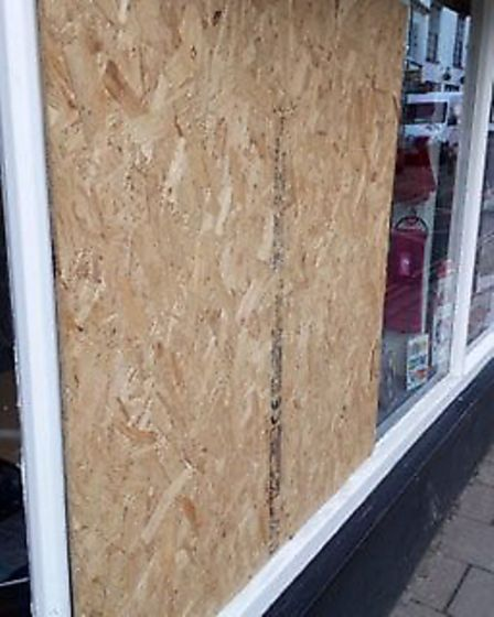 The front of Pearson's Newsagents had its window smashed. Picture: Karen Pearson