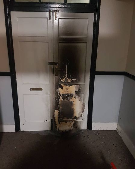 Fire damage on the front door of the pub. Picture: James Kirkness