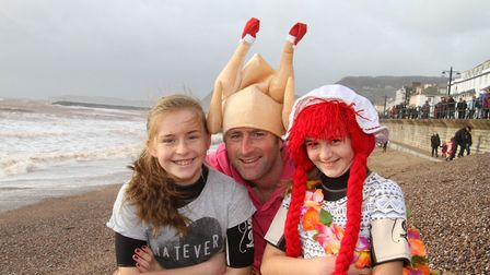 Ronnie Moore and his daughters Lucy and Rosie were disappointed that the boxing day swim had been ca