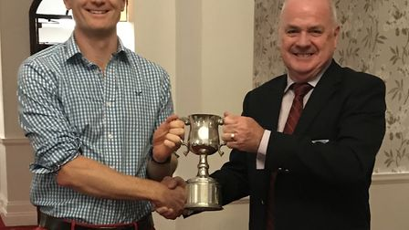 Will Murray receives the Sidmouth CC 1st XI Bowler of the Year award from Richard Brice of Somerset