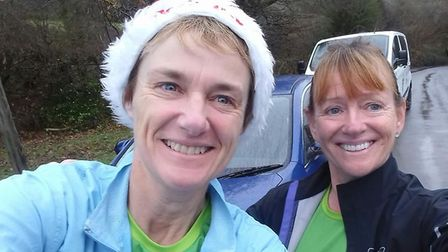 Sidmouth Running Club duo Jo Earlam and Jane Hemsworth who donned their Mighty Green (MG) shirts to
