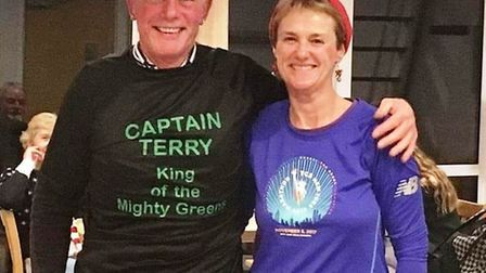 Sidmouth Running Club chairman Terry Bewes wearing the T-shirt that was presented to him by Jo Earla