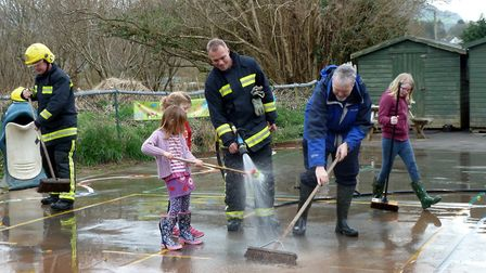 The clean-up operation at Tipton St. John Primary School gets underway with the help of Sidmouth fir