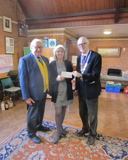 L-R Simon Card, Sidmouth Probus Press Officer; Andie Milne, Organiser Sidmouth Christmas Lunch; Malc