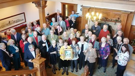 Members of the Sampson Society with the painting which was found by a buyer in the Isle of Wight. Pi