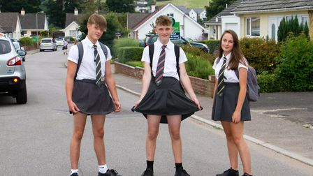 Sidmouth students Brad Jones and Jake and Holly White dressed in skirts. Ref shs 28 18TI 7797. Pictu