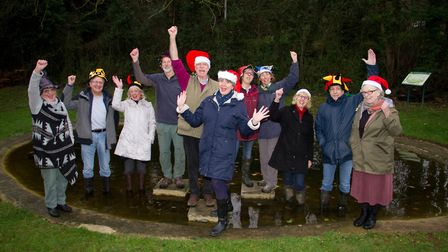 Simon Papworth with volunteers at the restored pond. Ref shs 51 18TI 7026. Picture: Terry Ife
