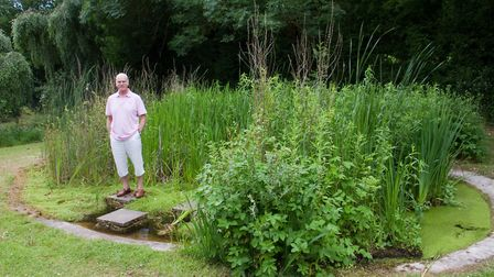 Simon Papworth at the pond in The Knapp. Ref shs 25 18TI 6047. Picture: Terry Ife