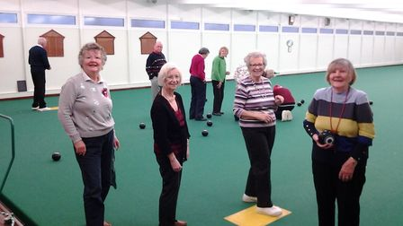 Sidmouth Bowls Club Christrmas Social and members taking part inthe fun bowls at the event. Picture