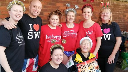 Members of Sidmouth Slimming World take part in the Boxing Day swim to mark another successful year