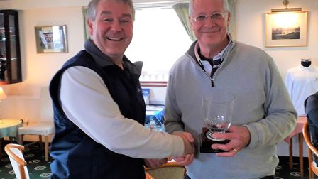 Sidmouth Golf Clubs Aylmer Cup winner Richard Powell (right), receiving his trophy from vice captain