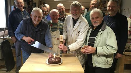 Members of the Men's Shed in Ottery celebrate its first birthday.