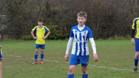 Rowan Hewitt in action for Ottery St Mary U13s during their meeting with table-topping Brixington Bl