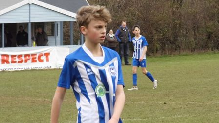 Seb Copp in action for Ottery St Mary U13s during their meeting with table-topping Brixington Blues.