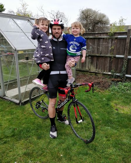 David Salter with his two daughers as he prepares to cycle from London to Paris in one day. Picture: