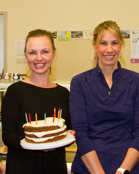 Owner of The Silver Otter Caroline Packer (holding cake) with Manager Helen Holmes. Ref sho 04 19TI