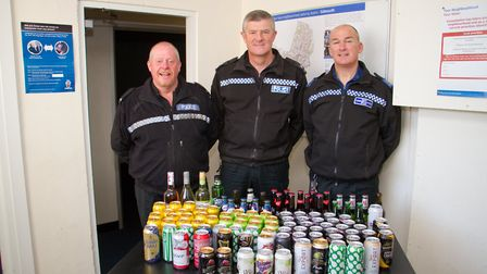 PC Steve Lee, Sgt Andy Squires and PCSO Phil Thomas with alcohol they are donating to The Sidmouth F