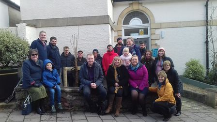 Members of Vivienne's family with the newly planted tree. Picture: Chris Abbott