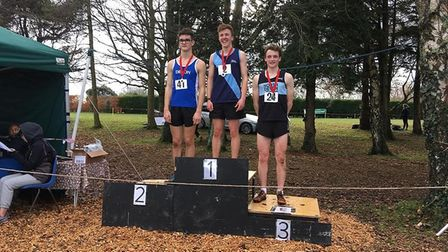 Sidmouth Running Club's Toby Garrick in first spot on the podium at the Devon Schools Cross Country