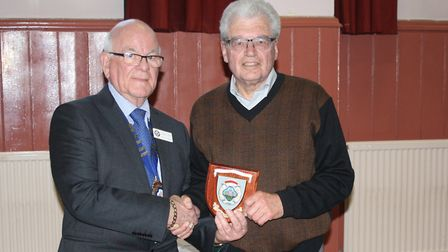 Ottery St Mary mayor, Glnn Dobson, hands over the Citizen of the Year award to Richard Coley. Ref sh