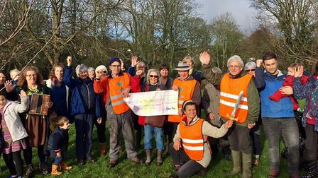 Nancy Craven from the Sid Vale Association presents a cheque to The Friends of The Byes. Picture: SV