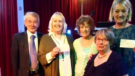 Jean Pollington, Mike Green and Ursula Summerwell present the fundraising cheques to CHSW community