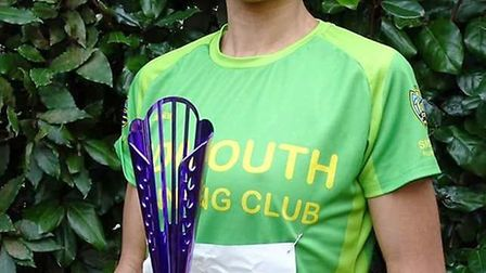 Sidmouth Running Club's Kirsteen Welch with a well earned trophy after the Gloucester Half Marathon.
