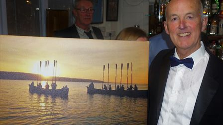 Sidmouth Gig Club's retiring chairman Jeremy Cloke with the mounted photo taken during the club's So