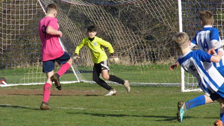 Ottery U13 goalkeeper Jack Hembrow about to make a save in the meeting with Exeter Panthers. Picture