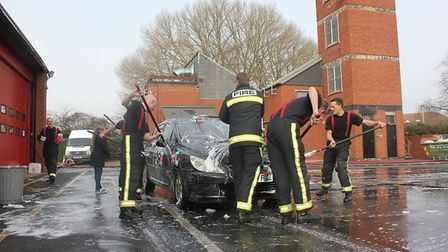 Firefighters will be competing in a national car wash competition this weekend. Picture: Devon and S