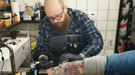 Stewart Lucas, known as the 'head bear' of the studio, tattooing. Picture: Silver Street Tatoos