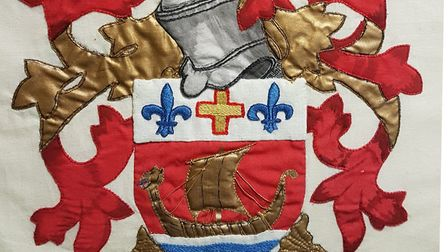 An embroidered version of the Sidmouth Town Council coat of arms at Kennaway House