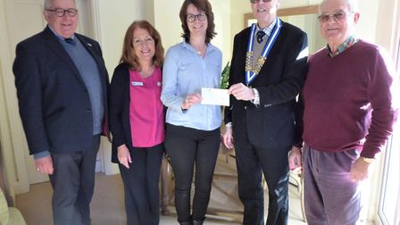 Simon Card OBE Malcolm Davies and Roy Lurvey, all formerly of the probus club present the cheque toS