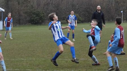 Ottery St Mary Under-13 player Finn Upsher in the thick of the action during his side's 4-1 win over