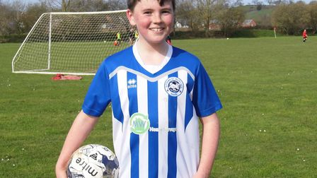 Ottery St Mary U13 player Freddie Clarke with the match ball after the 5-0 win at Moors of Tiverton.