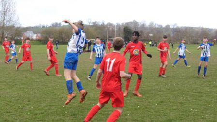 Sam Gleeson in the thick of the action for Ottery St mary U13. Picture STEPHEN UPSHER