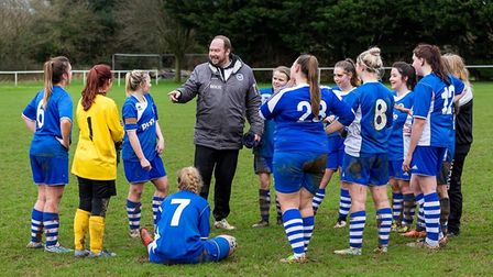 Half-time team talk conducted by Mike Ringer, the Ottery St mary ladies team coach. Picture by ANTHO