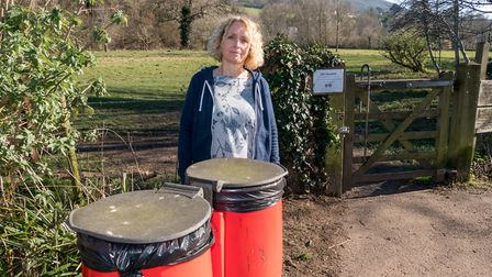 Sarah Jenkins with some dog bins in The Byes. Ref shs 09 19TI 1010061. Picture: Terry Ife