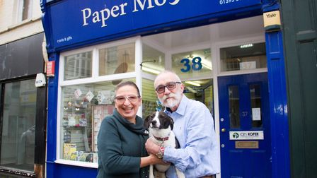 Jo and Martin Stone with their dog Brody outside their shop Paper Moon. Ref shs 14 19TI 1663. Pictur