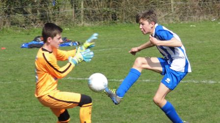 Ottery St Mary Under-13s striker Finn Upsher completes his hat-trick in the 4-0 win over Okehampton,