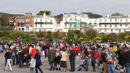 Sidmouth's traditional Hot Cross Bun giveaway on Good Friday. Ref: Archant 8163 140417 Good Friday