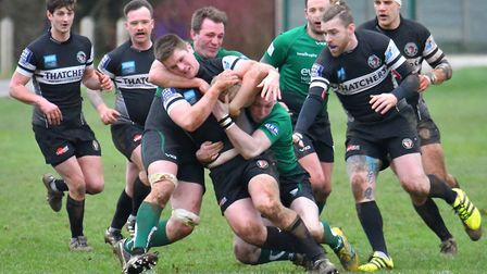 Sam Dearsley is held up by Sidmouth rivals (pic John Podpadec)