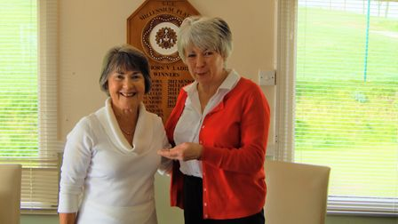 Sidmouth Golf Club's lady captain for 2019, Gill Padden (left receives the lady captain's brooch of