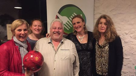 Auction winner Sarah Birnie with her Manchester United signed football, Alana Medforth from River Co