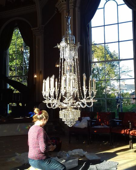 Mandy Wilkinson pieces the newly restored chandelier back into place at Sidholme Music Room. Picture