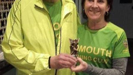 Sidmouth Running Club's David Skinner being presented with a trophy for completing his 100th Parkrun