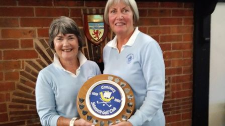 Sidmouth lady captain Gill Paddon (left) presenting the Centenary Plate to the Sheelah Creasy team c